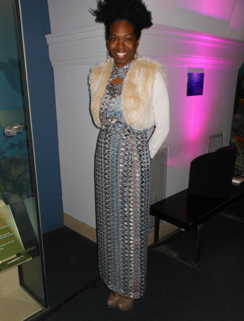 We couldn't help notice the statuesque Adrienne Nicole upstairs who was rocking a vibrant multicolor Moshood Creations dress with metallic accent that she found in a local independent African Euro boutique.