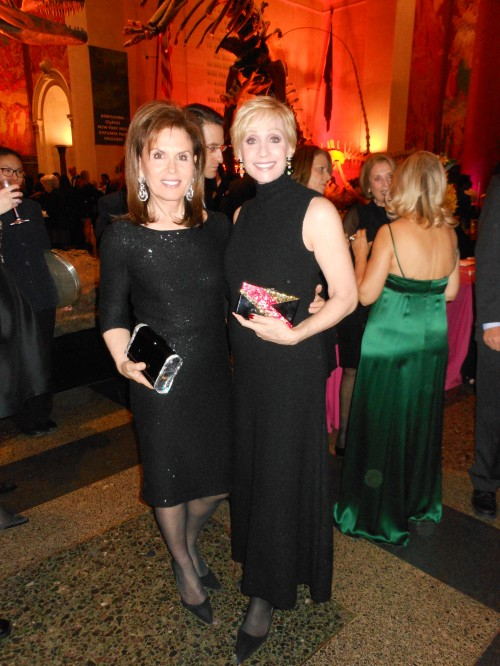 Bonnie Englebardt Lautenberg is shimmers in an Oscar de la Renta number that flatters her curves and elevates her elegant look. Next to her is Carol Weisman wearing a to-die-for classic Chanel maxi dress with a high mock turtleneck. Both ladies are carrying Edie Parker clutches.