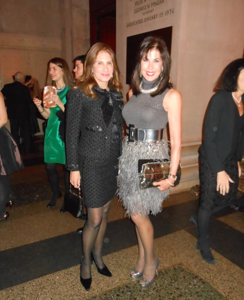 Lauren Roberts is sensational in a stunning vintage Chanel suit and carrying a Gucci handbag.  Next to her is Denise Wohl, wearing an alluring Yves St. Laurent dress paired with a bag from new elegant and practical handbag collection Deesigns by Dee Ocleppo ,aka Mrs. Tommy Hilfiger.