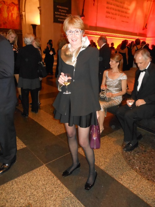 "Wendy Jeffers pulls off the ""anything but a cocktail dress"" with a huge dose of style. She pairs her satin-collared  Armani jacket with a full skirt by Herve Leger. Her chic eyeglasses are by Alain Mikli."