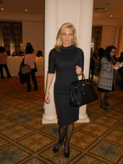 Viktoria Cameron is wearing a MaxMara dress, Her bag is Hermes.